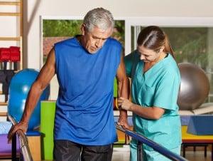 Senior man doing running training with physiotherapist in nursin